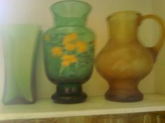 Beautiful green vase with yellow flowers